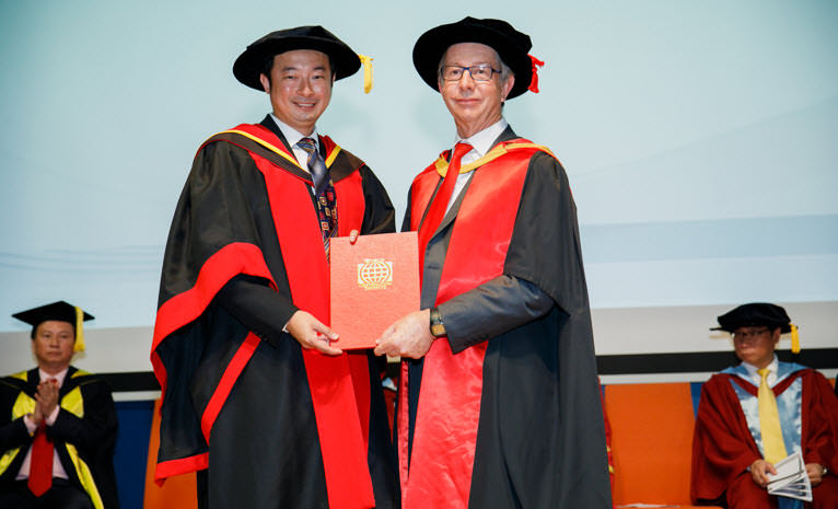 Dr David Cheang receiving his Doctorate in Business